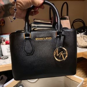 Michael kors handbags and mini satchels